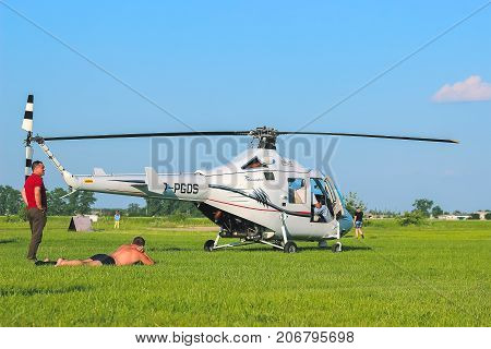 Zhytomyr Ukraine - May 05 2015: Young Man Sunbathing at helicopter starting competition