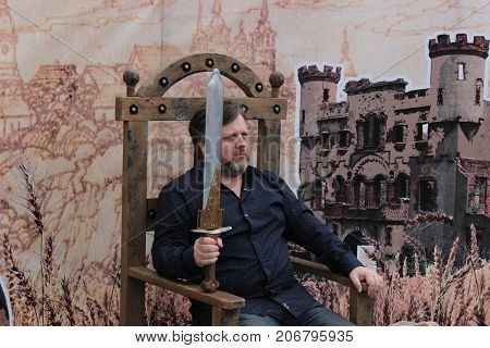 Zhytomyr Ukraine - September 23 2016: Portrait of a romantic fat man with a sword