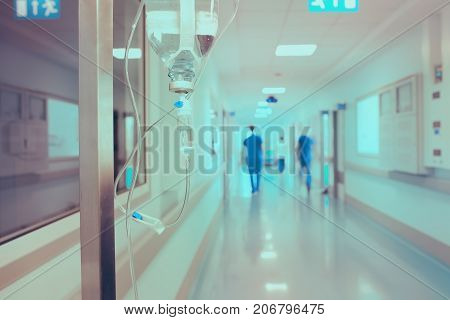 Walking medical workers in the hospital on the background of drip.