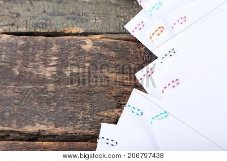 Sheet Of Papers With Paperclips On Wooden Table