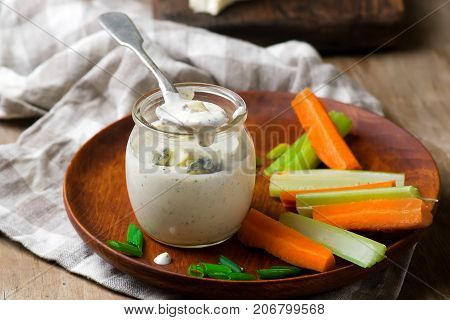 Blue cheese dressing in glass jar.selective focus