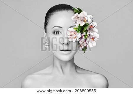 Beautiful Nude asian attractive brunette with flowers on his head. Fashion beautiful makeup clean skin facial care. Portrait of young asian beautiful woman with perfect skin black and white