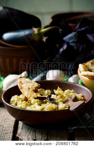 Eggplant pate in ceramic bowl. style rustic. selective focus