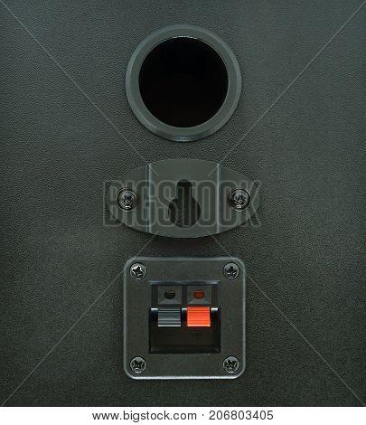 Stereo speakers in wooden case audio speaker backside