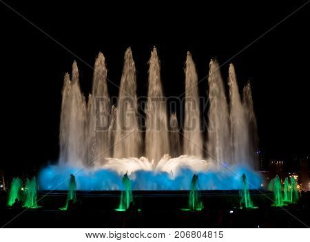 An evening water fountain show in Barcelona