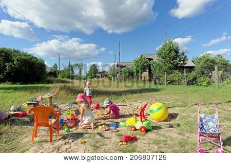 Ivanovo Region, Russia. - July 17.2016. Children Play On The Improvised Playground On A Dirt Road In