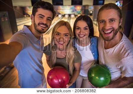 Friends Playing Bowling