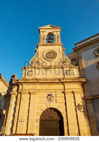 Principal facade of Torre dell´Orologio (Clock tower) in background. Galatina, Apulia, Italy.