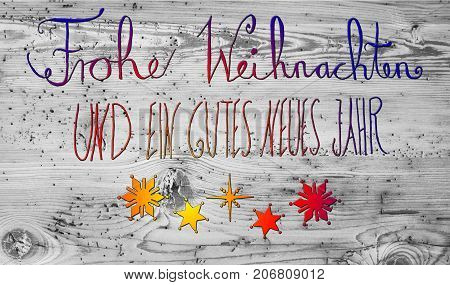 Colored German Calligraphy Frohe Weihnachten Und Ein Gutes Neues Jahr Means Merry Christmas And Happy New Year. Gray Vintage Wooden Background