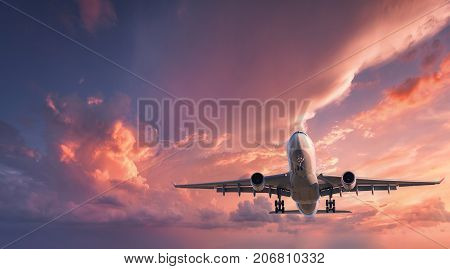 Passenger Airplane Is Flying In The Red Sky