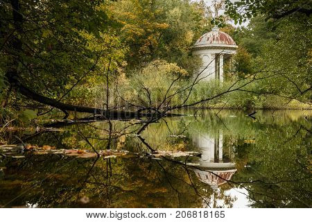Classical White Rotunda On The Shore Of A Pond.
