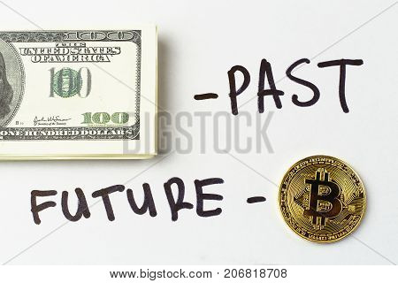 Bundle of hundred dollar bills and inscription -  past, gold coin of crypto currency Bitcoin and inscription - future, toned