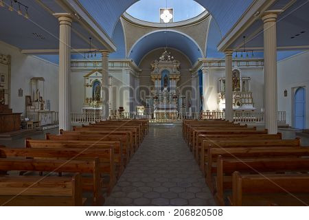 Pica, Tarapaca, Chile - August 28, 2017: Interior of the historic church of San Andres in the village of Pica in the Atacama Desert, Tarapaca, Chile.