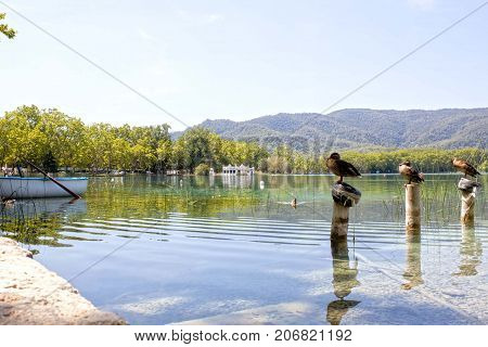 Bañola Lake With Ducks, Boats In A Sunny Day
