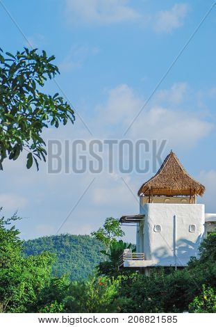 Small mountain hut on a hill and blue sky