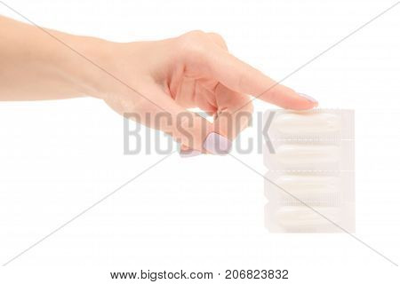 Female hand holding suppositoria medicine on white background isolation