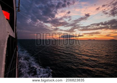 Big passenger boat in the ocean amidst the beautiful nature of the evening sea and the colorful sky during sunset while cruising to Koh Samui Island in Surat Thani Thailand