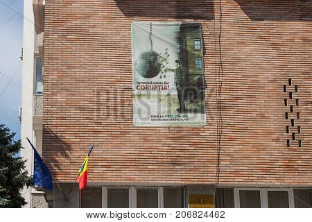 DROBETA TURNU SEVERIN ROMANIA - SEPTEMBER 22 2017: Anti Corruption poster displayed on a state administration HQ wall in Turnu Severin Transylvania. Romania is considered to be one of the most corrupt countries of the European Union