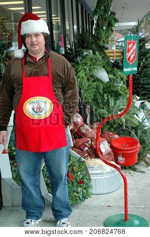 DECEMBER 4, 2004. SEATTLE, WA. CIRCA:  Male bell ringer with the salvation army asking for donation during the xmas holiday season.