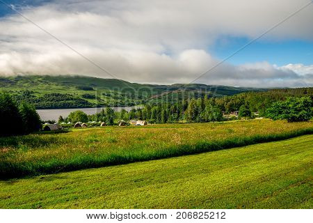 Loch Tay, central Scotland, April 2017: A view from a disc golf course fairway to Loch Tay Highland Lodges wigwam village