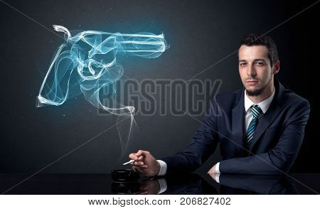 Businessman resting and smoking in a dark room.