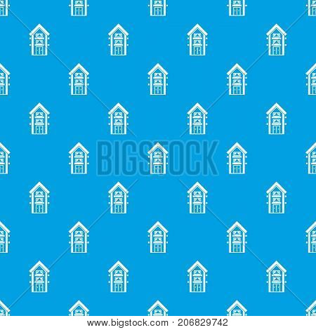 Two-storey house with balconies pattern repeat seamless in blue color for any design. Vector geometric illustration