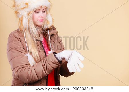 Blonde Woman In Winter Hat And Gloves
