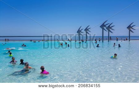 Popular attraction in Cairns is the Public Lagoon on the  Esplanade people enjoying a swim on a hot day  in October 25th 2017