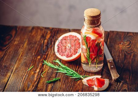 Detox Water Infused with Sliced Grapefruit and Fresh Springs of Rosemary.