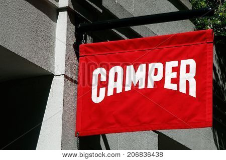 New York September 25 2017: Red Camper banner is suspended above the entrance to their store in SoHo.