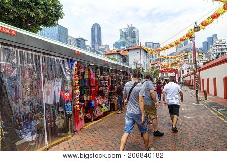 SINGAPORE - SEPTEMBER 11 2017: Shoppers visiting Chinatown for bargain souvenirs and authentic local food.
