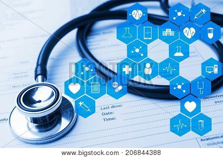 stethoscope and medical information form on desk with medical icon in hexagon pattern blue color tone laboratory science chemical and medical research conceptstethoscope and medical information form on desk with medical icon in hexagon pattern blue color