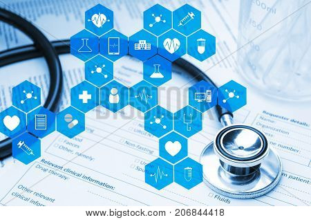 stethoscope test tube beaker and medical information form on desk with medical icon in hexagon pattern blue color tone laboratory science chemical and medical research concept