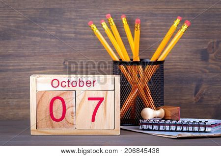 October 7. close-up wooden calendar. Time planning and business background.