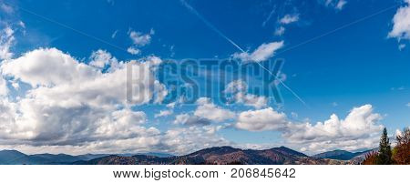 Beautiful Cloudscape Over The Mountain Ridge