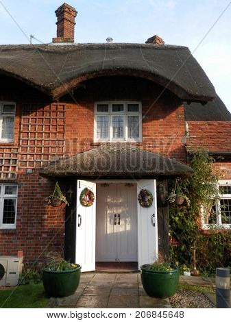 Hampshire England - December 31 2014: Thatched Entrance to public house in rural Southern England
