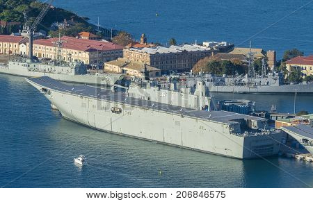 Sydney, Australia - May 16, 2017: Aerial view of HMAS Adelaide of the Royal Australian Navy. It is a helicopter carrier and amphibious assault ship.