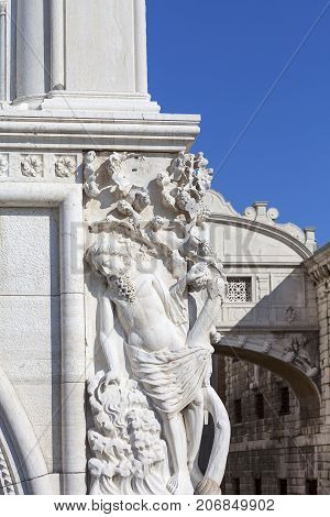 Doge's Palace on Piazza San Marcorelief on facade and Bridge of Sighs Venice Italy. The palace was the residence of the Doge of Venice the museum is currently located here