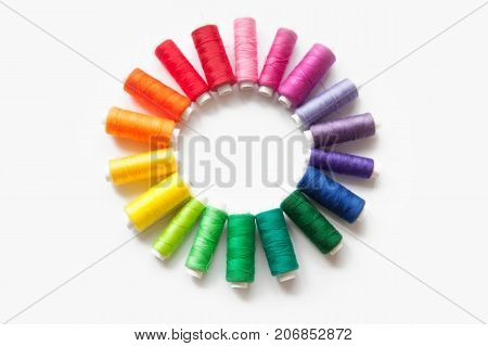 Color Thread For Sewing. White Background. A Circle Of Thread Reels.