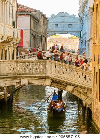 VENICE, ITALY - SEPTEMBER 3, 2013: Gondola on the channel and Bridge of sighs. Venice, Italy