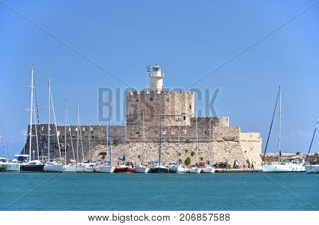 Fort of St. Nicholas with the lighthouse in Mandraki harbor, Rhodes island, Greece