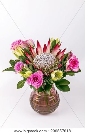 Potted Arrangement Of Protea And Pink Rose Flowers