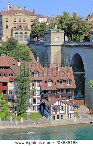 The picture was taken in Switzerland. The picture shows a part of the oldest in Bern Untertorbruecke bridge over the River Aare and houses underneath.