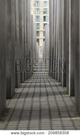 Berlin, Germany: May 20, 2015: Memorial to the Murdered Jews of Europe. View along the pillars of the Holocaust Memorial in Berlin.