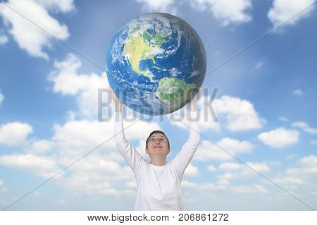 Smiling woman holding Earth planet. Ecology concept.
