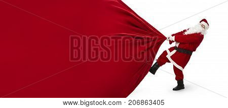 Santa Claus pulling huge bag of presents isiolated on white background with copy space