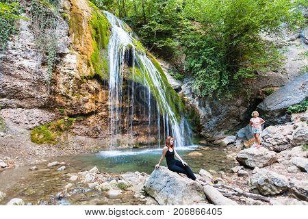 Tourists Near Djur-djur Waterfall In Crimea