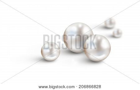 Pearl background on white - White pearls in foreground and two in background with diminishing depth of field. Space for text