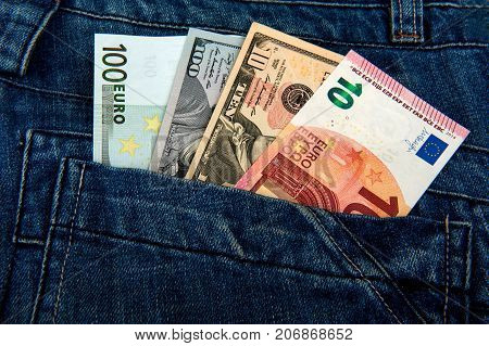 money in a jeans pocket, dollars, euro, pocket with money