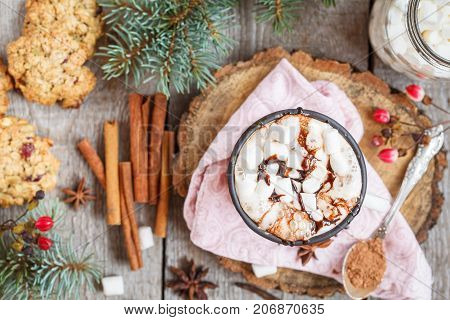 Hot Christmas cacao with marshmallow in the New Year decorations top view.